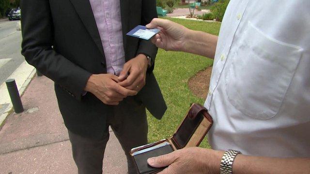 Man holds European Health Insurance Card