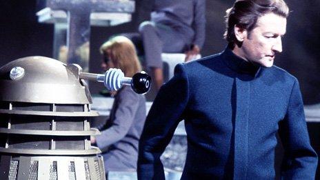 Aubrey Woods alongside a Dalek in Doctor Who