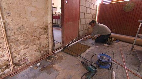 Workers repair the building