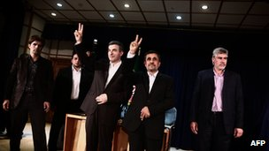 Iranian President Mahmoud Ahmadinejad and Esfandyar Rahim Mashaie make the victory sign during a press conference