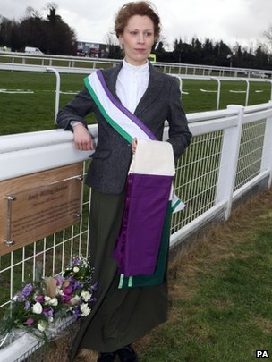 Woman dressed in Votes for Women colours at the unveiling of Emily Davison plaque at Epsom