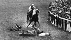 Emily Davison on the racecourse after being hit by the horse