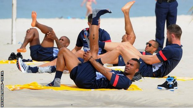 Ashley Cole looks on during the England team warm down session on Copacabana Beach ahead of their friendly match against Brazil