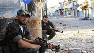 Syrian rebel fighters in the town of Qusair (5 May 2012)