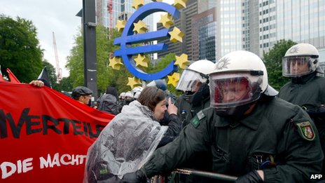 Protesters and police face-off outside the European Central Bank (ECB) in Frankfurt am Main, central Germany on May 31, 2013