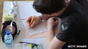 A French student works on the test of Philosophy as he takes the baccalaureat exam