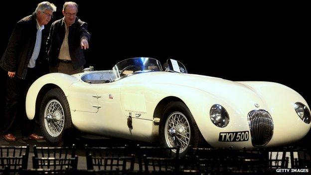 Two men admire a 1952 C-type Jaguar
