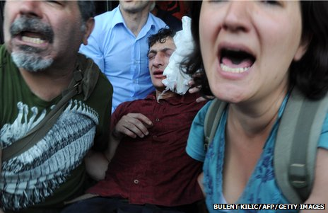 A wounded protestor is carried away during confrontations with riot police (31 May 2013)
