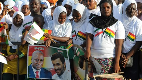 Supports of Mahmoud Ahmadinejad wait to welcome him in Accra, Ghana