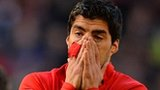 Luis Suarez charged over bite