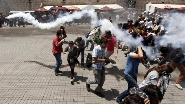 Riot police use tear gas to disperse the crowd during an anti-government protest at Taksim Square