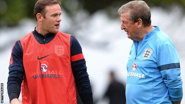 Wayne Rooney (left) and Roy Hodgson