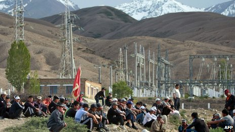 Protesters sit outside power substation in Kyrgyz village of Tamga on 31 May