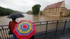 People look out from a bridge over the river Mulde at the flooded embankments of Grimma, near Leipzig June 2, 2013.