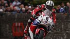 Race winner Michael Dunlop pictured onboard his Superbike powering through St Ninian's crossroads
