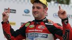 Ballymoney's Michael Dunlop savours his big moment after winning the Superbike race at the TT Races