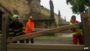 Emergency services erect metal barriers near the Charles Bridge in Prague on 2 June 2013