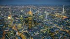 Night aerial view over City of London looking south-east