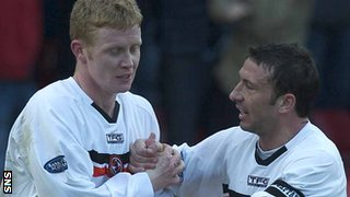Robson and McInnes celebrate with Dundee United
