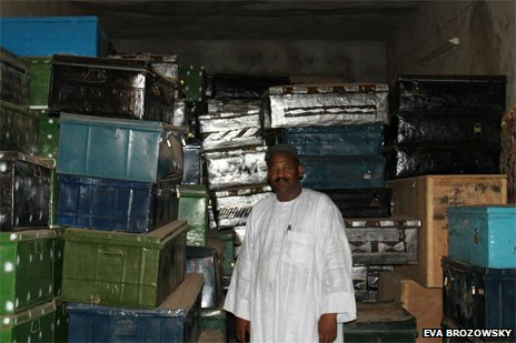 Dr Abdel Kader Haidara with boxes containing the rescued manuscripts