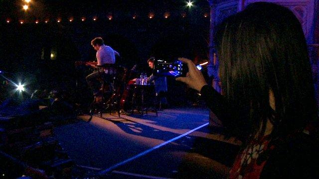 LJ Rich filming a gig