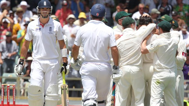 Kevin Pietersen waits for a decision as Australia celebrate his wicket