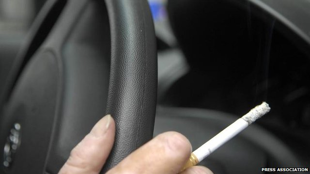 Smoking a cigarette in a car
