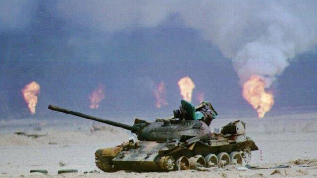 Kuwaiti oil wells on fire behind an Iraqi tank, 1991
