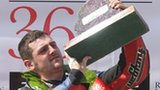 Michael Dunlop with the Superstock trophy