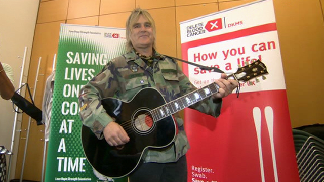Mike Peters playing his guitar