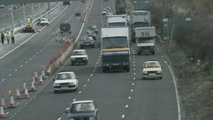 Middle-lane hogging traffic on a busy road