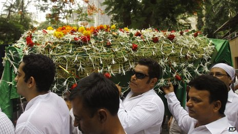 Friends and relatives carry a coffin carrying the body of Bollywood actress Jiah Khan during her funeral in Mumbai, India, Wednesday, June 5, 2013