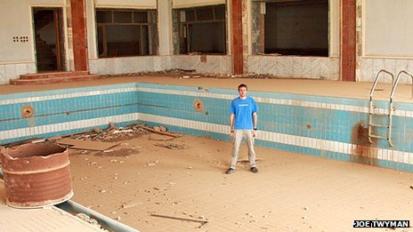 Joe Twyman in the ruins of a swimming pool which belonged to Saddam Hussein