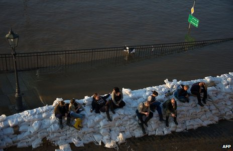 People sit on sandbags in Dresden, 4 June