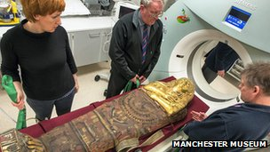A mummy going into a CT scanner