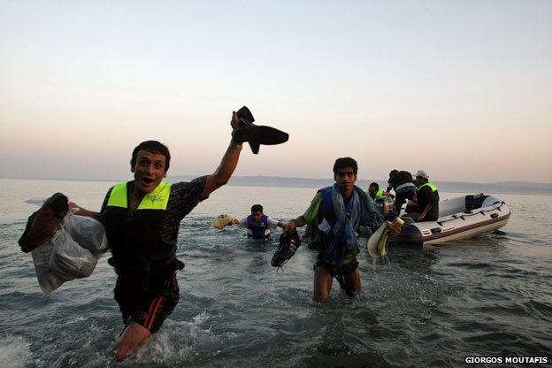 Syrian refugees clamber ashore, Lesbos