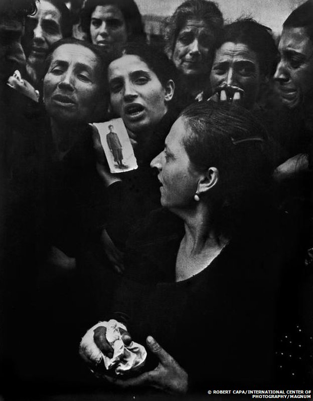 People mourn at the funeral of 20 teenagers in Naples, 1943