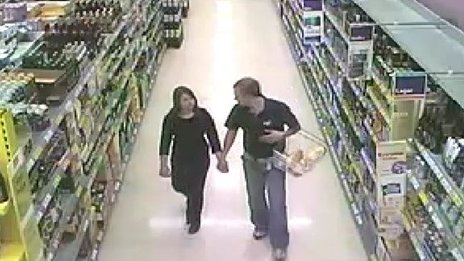 Catherine Wells-Burr and Rafal Nowak in a supermarket holding hands