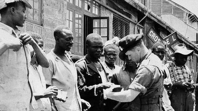 British soldiers quizzing Kenyan men