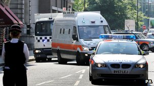 Police vans believed to be carrying the six men