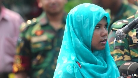 Reshma Begum talks to the media at Savar Cantonment Hospital on the outskirts of Dhaka on 6 June 2013