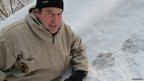 Dr Dale Miquelle, Siberian tiger expert with paw prints