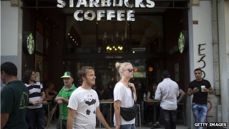 Tourists walk past Starbucks in Istanbul