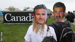 Fans wearing David Coulthard and Eddie Jordan facemasks