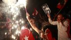 An anti-government protester waves a flare during a rally in Ankara