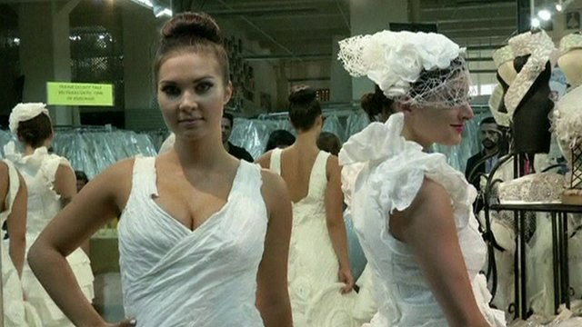 Models wearing paper gowns