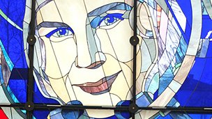Elena Tereshkova in front of the stained glass portrait of her mother
