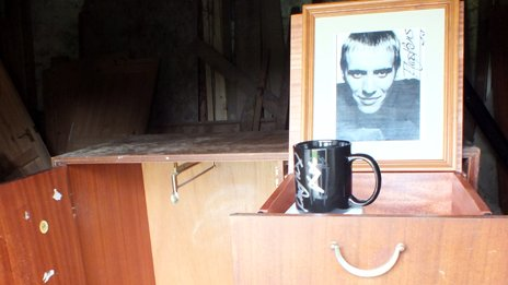Autographed photograph of Rhys Ifans on the wardrobe he donated to his former school