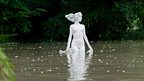 A statue is seen in the floodwater of the Moson branch of Danube in Gyor, 120 kms west of Budapest, Hungary, 6 June 2013