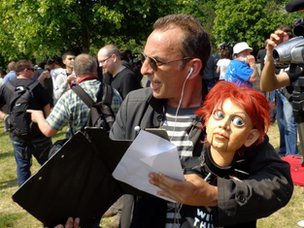 Bilderberg protester Judd Charlton with his ventriloquist's dummy, Phyllis